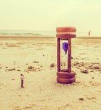mini figure dolls photographer take picture on sandglass Stock Photography