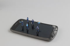 Mini of figure police squad protect on mobile Stock Photo