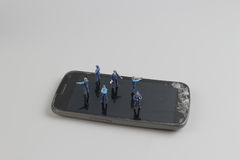 Mini of figure police squad protect on mobile Stock Photos