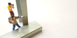 Top View 2 Mini Figure toy photographer take a photo, hiding at strapler on white stock photos