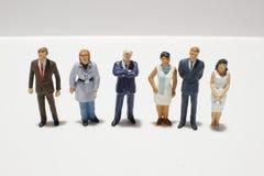 Mini figures of business on white back ground. Mini figures of business on a white back ground royalty free stock photo