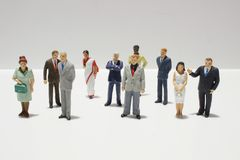 Mini figures of business on white back ground. Mini figures of business on a white back ground royalty free stock images