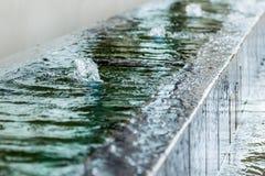 Mini fila della fontana Fotografia Stock