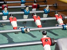 Mini football game table in close up view. Detail of players on mini football game on table on the beach royalty free stock image