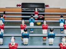 Mini football game table in close up view. Detail of players on mini football game on table on the beach stock images