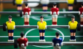 Mini football game table in close up view. Close up of player on mini football game on table, The concept of fighting in business, vignette filter effect and Stock Photo
