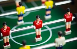 Mini football table in close up view. Close up of player on mini football game on table, The concept of fighting in business, vignette filter effect and Stock Image