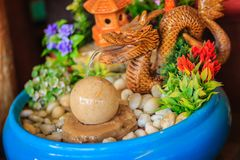 Mini fountain for garden decoration with dragon splash and jet o Royalty Free Stock Photography