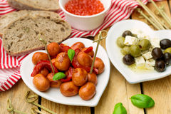 Mini Frankfurter sausage hot-dog in sour sweet sauce with bell p Stock Photos
