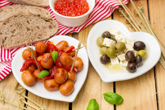 Mini Frankfurter sausage hot-dog in sour sweet sauce with bell p Royalty Free Stock Images