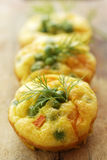 Mini frittata with green peas and carrot Stock Photography