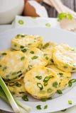 Mini frittatas with peas, green onion and feta Royalty Free Stock Photos