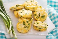 Mini frittatas with peas, green onion and feta Royalty Free Stock Photo