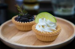 Mini fruits and cream pie tarts stock photography