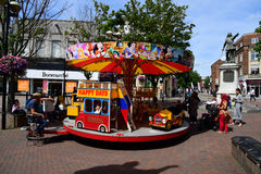 Mini fun fair, Aylesbury, Buckinghamshire. A child`s roundabout in Aylesbury town centre Royalty Free Stock Photography