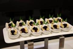 Mini gâteau au fromage de myrtille Photographie stock