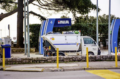 Mini Garbage truck on a gas station Stock Image