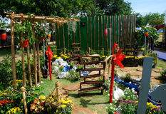 Mini garden built using recycled materials. PUTRAJAYA, MALAYSIA -MAY 30, 2016: Small pocket garden made from mix of recycle material and flower at Floria Garden Stock Photos