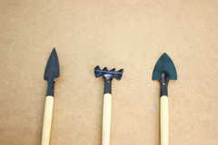 Mini garden tools on wooden board. With space for text royalty free stock photography
