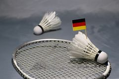 Mini Germany flag stick on the shuttlecock put on the net of badminton racket and out focus a shuttlecock royalty free stock photos