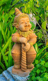 Mini giant statuary. In the garden Royalty Free Stock Photography