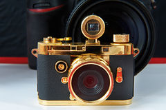 Mini gift golden camera Royalty Free Stock Image