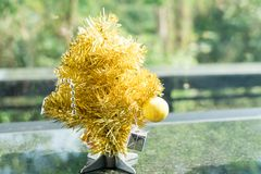Mini golden Christmas tree with hanging of small present Royalty Free Stock Images
