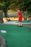 Mini-golf Anyone?. A little boy playing miniature golf Stock Images