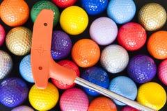 Mini Golf Balls und Verein Lizenzfreie Stockfotografie