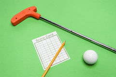 Mini Golf club with score card, ball and pencil Stock Images