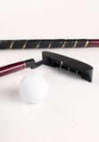 Mini golf equipment - ball and stick Stock Photography
