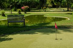 Mini golf field with red flag at the tropical island at Maldives. Mini golf field with red flag located at the beautiful tropical island at Maldives Stock Image