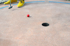 Mini Golf. On the hole close up Royalty Free Stock Image