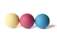 Mini Golf Material - 12. Yellow, Red and Blue colored Mini Golf balls on an isolated background Stock Image
