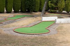 Mini golf green obstacle hole stock images