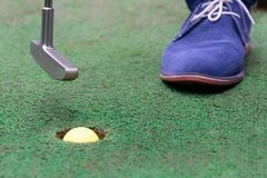 Mini golf player victory close up background stock photography