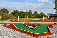 Mini golf ready to play. Outdoors scene. Hole at a miniature golf course Royalty Free Stock Photo