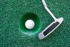 Mini golf scene with ball and club Stock Image