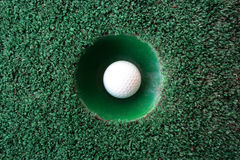 Mini golf scene with ball and hole Royalty Free Stock Image