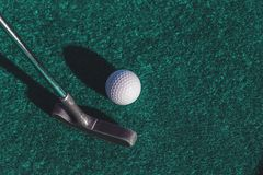 Mini golf putter club and ball stock photo