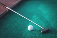 Mini golf putter club and ball royalty free stock photo