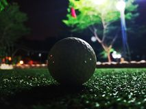 Mini golfing. Green grass golfing night scene royalty free stock image