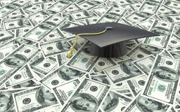 Mini graduation cap on US money - education costs Royalty Free Stock Image