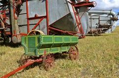 Mini grain wagon and threshing machines Royalty Free Stock Images
