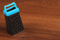 The Mini Grater on the wood Royalty Free Stock Photos