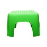 Mini green plastic stool on white background Stock Photos