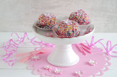 Mini gugelhupf with sugar sprinkles. Mini gugelhupf with colorful sugar sprinkles royalty free stock image
