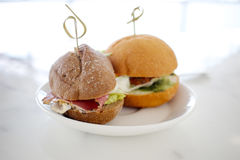 Mini Hamburger on white dish on  background. Royalty Free Stock Image