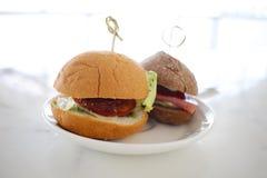 Mini Hamburger on white dish on  background. Stock Images