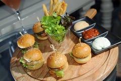 Mini hamburgers Stock Images